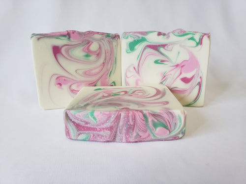 Sweet Pea Handmade Soap - Imagine an English garden resplendent with sweet pea, hyacinth, lily of the valley, violets, and wild jasmine.  Now imagine these scents surrounding you in your shower every morning.  You can enjoy this wonderful fragrance anytime with our Sweet Pea soap.  Ingredients:  Olive Oil, Coconut Oil, Organic Palm Oil (ethically and sustainably sourced), Water, Sodium Hydroxide, Shea Butter, Sweet Almond Oil, Meadowfoam Oil, Castor Oil, Fragrance, Kaolin Clay, Skin-Safe Colorants