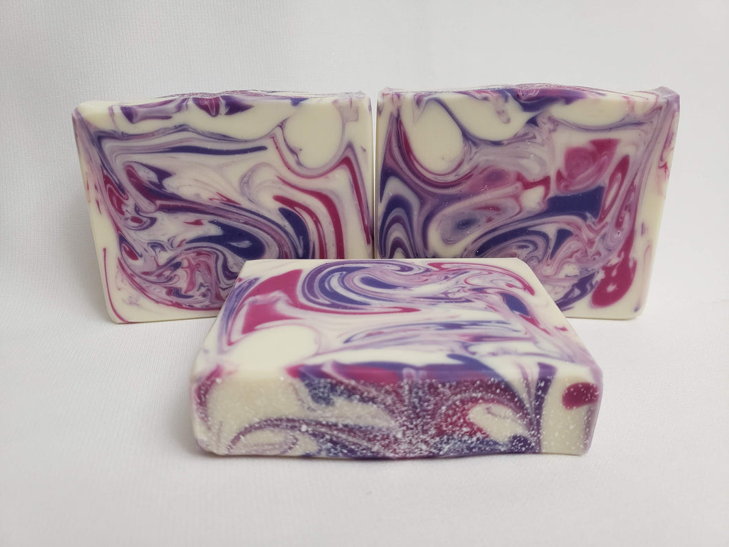 Blackberry Ambrosia Handmade Soap - A fruity blend with hints of sugary sweet notes at the base.  Top notes of blackberry and apple complimented by floral notes, melon, and sugar.  Ingredients:  Olive oil, coconut oil, organic palm oil, water, sodium hydroxide, shea butter, sweet almond oil, meadowfoam oil, caster oil, fragrance, kaolin clay, skin-safe colorants