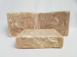 Caramel and Honey Handmade Soap -   A beautifully warm honey blush color with delicate white swirls perfectly reflect the creamy honey and sweet caramel scent of this soap.  Compare this scent to Lush's Honey I Washed the Kids.  Ingredients:  Olive oil, coconut oil, organic palm oil, water, sodium hydroxide, rice bran oil, sweet almond oil, meadowfoam oil, caster oil, fragrance, kaolin clay, skin-safe colorants