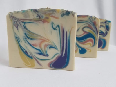 Hello Sweetie Handmade Soap - A lovely blend of raw turbino sugar, lemon zest, meringue, whipped cream, and Madagascar Vanilla.  This scent is hard to describe and even harder to resist!  Ingredients:  Olive Oil, Coconut Oil, Organic Palm Oil (ethically and sustainably sourced), Water, Sodium Hydroxide, Shea Butter, Meadowfoam Oil, Sweet Almond Oil, Castor Oil, Fragrance, Kaolin Clay, Skin-Safe Colorants