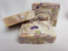 Load image into Gallery viewer, Persephone's Kiss Handmade Soap - Mandarin orange, melon, blackberry, and violet leaf comprise the top notes of this soap's scent.  These are followed by lavender, jasmine, lily of the valley, and nectarine and ending with fresh honey, oak, and musk.  Ingredients:  Olive Oil, Coconut Oil, Organic Palm Oil (ethically and sustainably sourced), Water, Sodium Hydroxide, Shea Butter, Sweet Almond Oil, Castor Oil, Meadowfoam Oil, Fragrance, Kaolin Clay, Skin-Safe Colorants