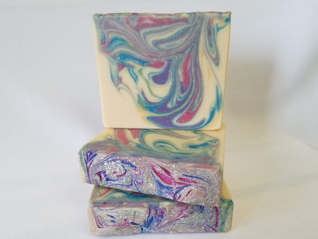 Rainbow Fruit Swirls Handmde Soap - This is such a fun soap!  With a fruit mix of lemon rind, lime, grapefruit, lemongrass, lily, and verbena with a very deep vanilla sugar base.  It will definitely remind you of everyone's favorite fruit ring cereal.  Ingredients:  Olive Oil, Coconut Oil, Organic Palm Oil (ethically and sustainably sourced), Water,  Sodium Hydroxide, Shea Butter, Meadowfoam Oil, Sweet Almond Oil, Castor Oil, Fragrance Oil, Kaolin Clay, Skin-Safe Colorants