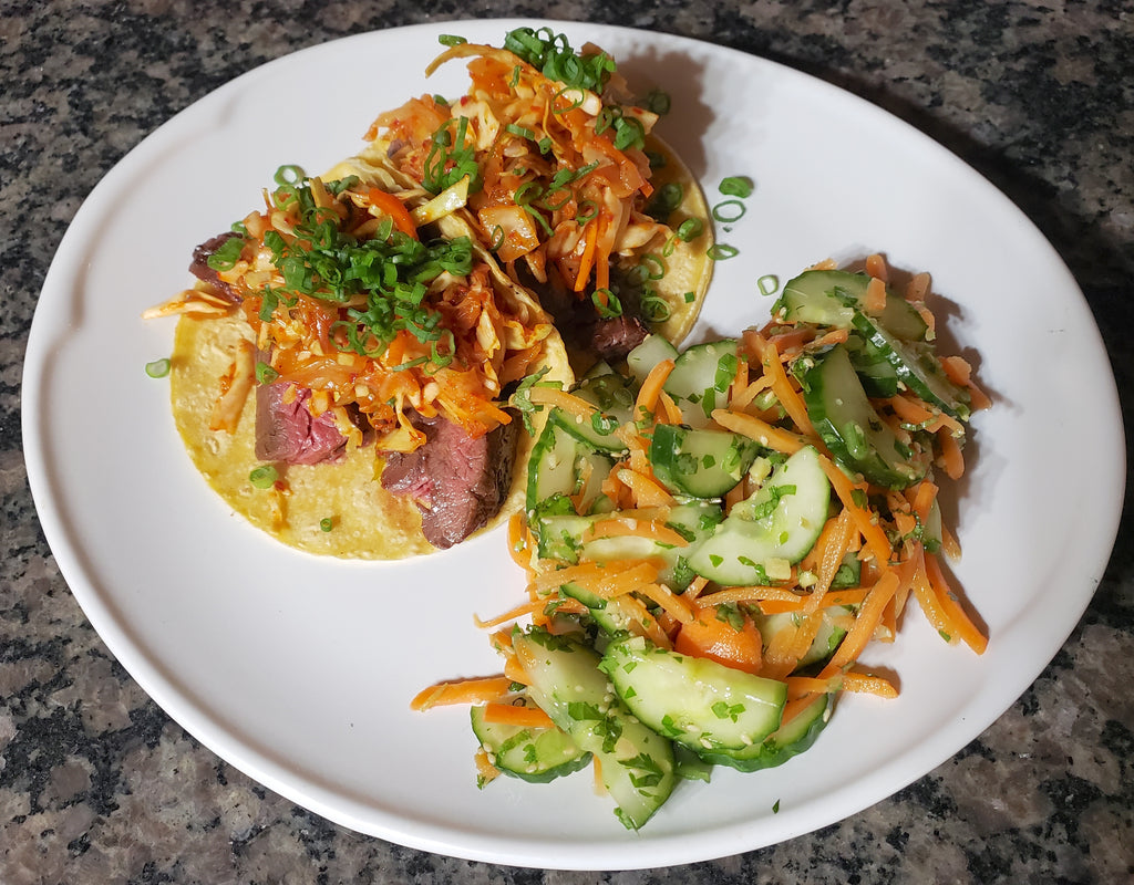 Skirt Steak Tacos with Kimchi Slaw and Carrot Cucumber Salad
