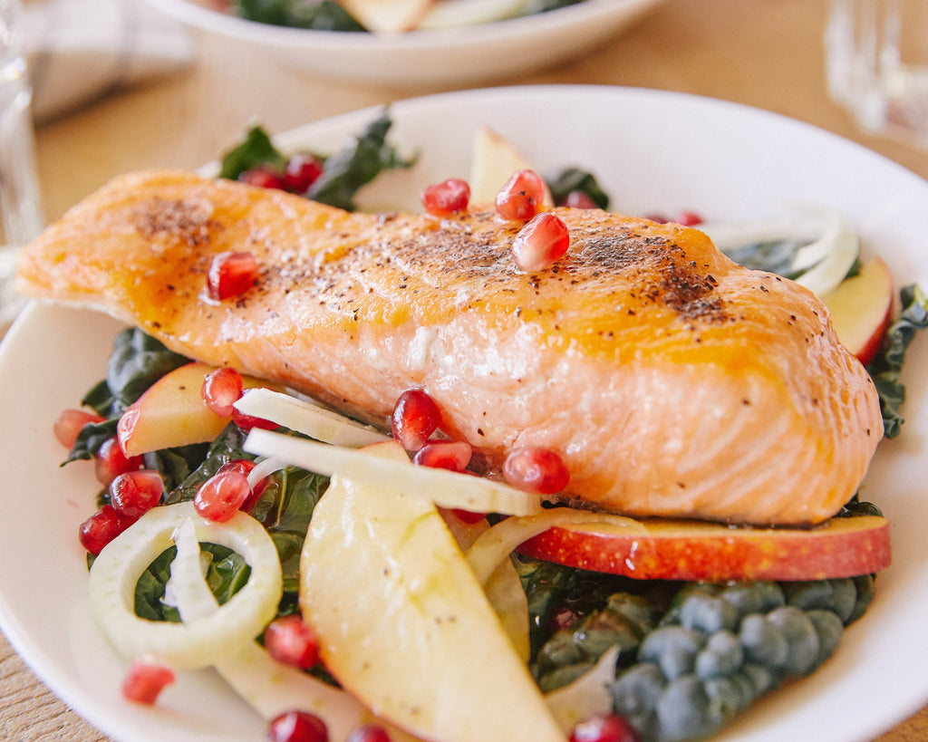 Grilled Salmon Kale Salad with Apple, Fennel & Pomegranate
