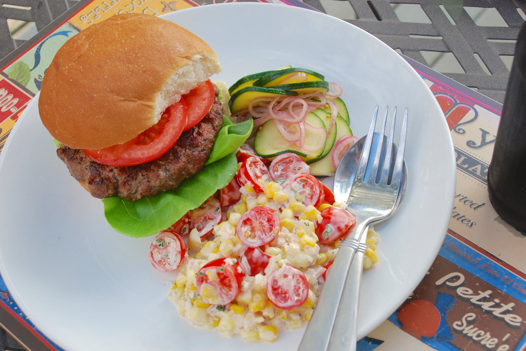 Grassfed Beef Burger with Quick Zucchini Pickles and Corn Tomato Salad