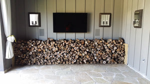 1/2 cord almond firewood stacked