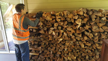 Load image into Gallery viewer, 1/2 cord almond firewood stacked