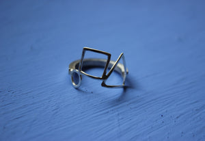 Square band open shapes ring