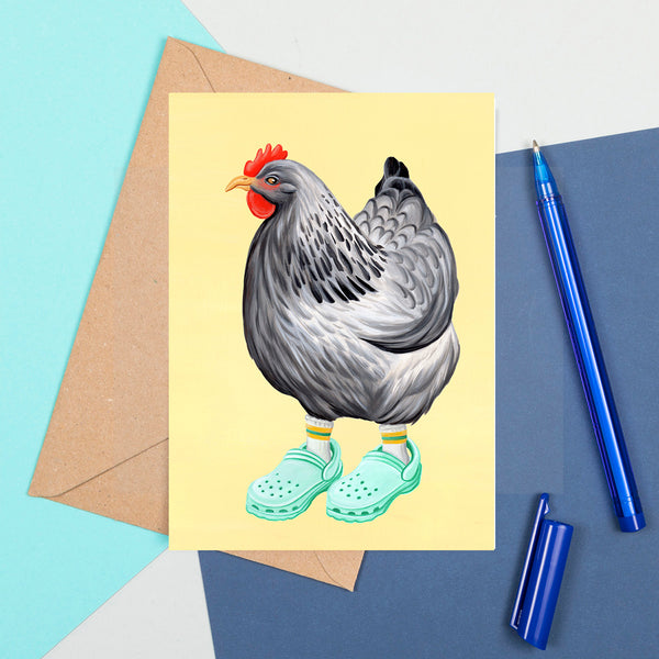 Hen wearing Crocs shoes, card