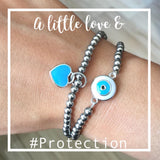 "Turquoise Blue Love Heart Charm or Evil Eye Charm 7"" ladies 4mm bracelet"