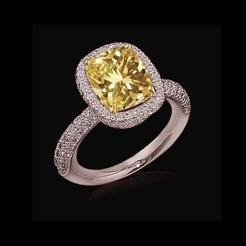 Yellow cushion cut diamonds ladies ring 4 carats white gold
