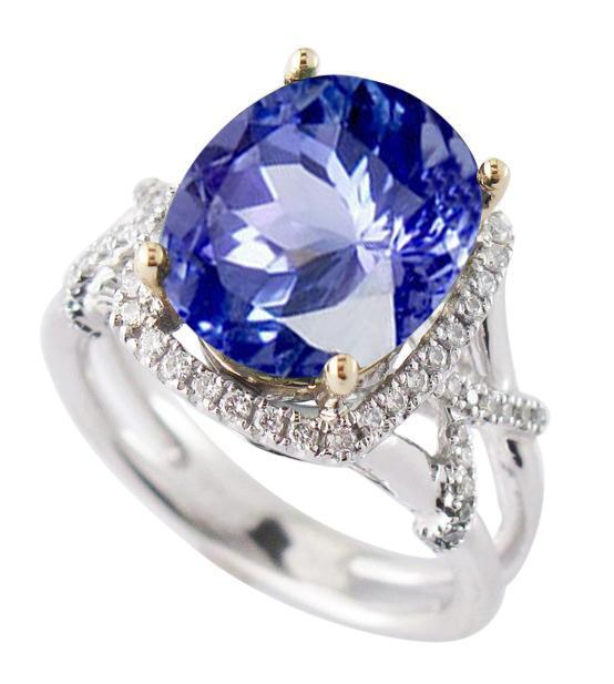 White & yellow gold 14K ceylon sapphire and oval & round cut 7.81 carat diamonds engagement ring