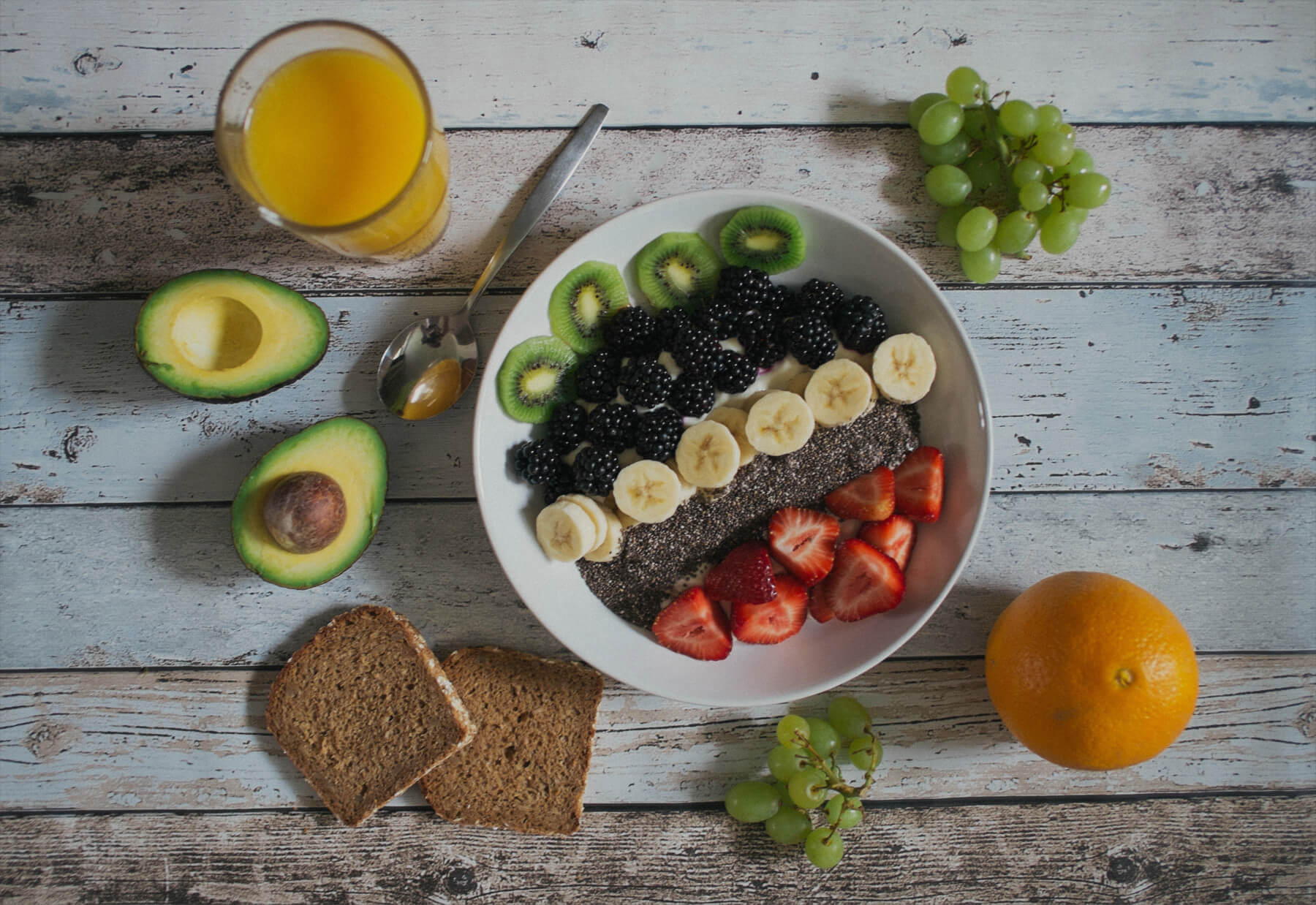 a healthy table of vegan food with lots of fruits