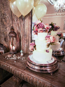 large 3 tier wedding cake on antique stand at Cerrig Bran Hotel Anglesey North Wales