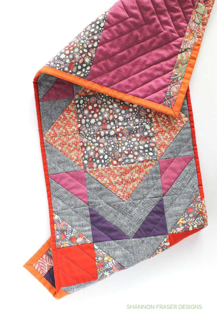 Modern Aztec quilted table runner featuring Fantasy fabric with Artisan cotton + linen