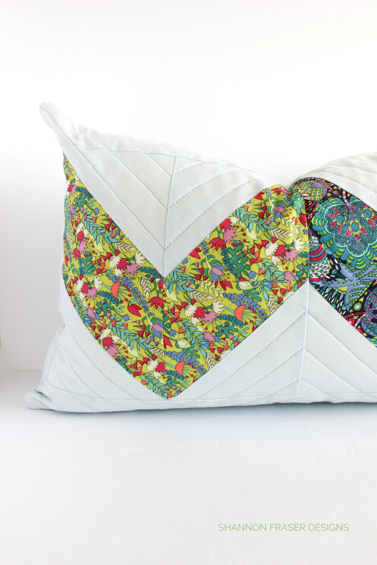 Double Chevron quilted pillow in light blue essex linen with chartreuse and navy floral prints