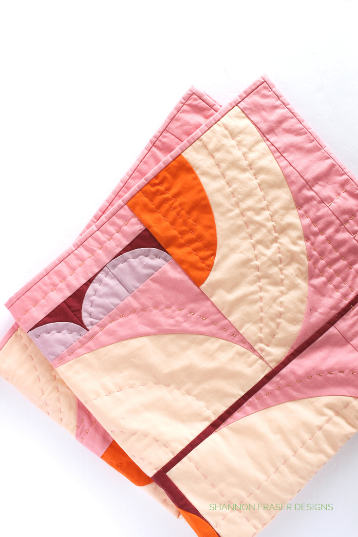 Peach, orange, coral, burgundy and lavender Cloud Surfing baby quilt | Shannon Fraser Designs