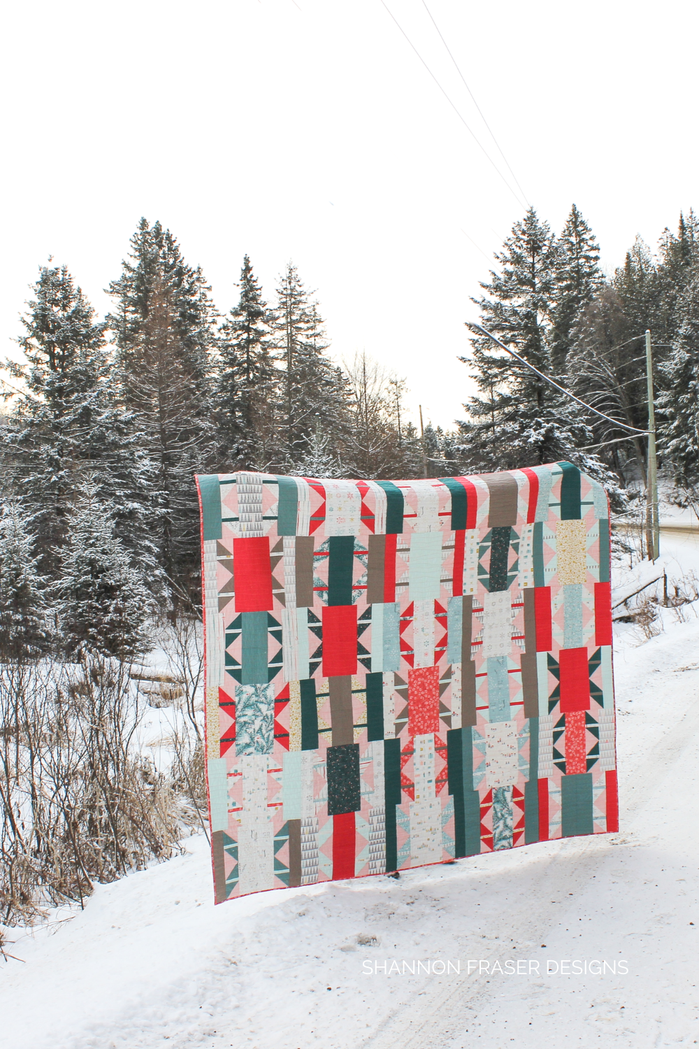 Shattered Star Holiday Quilt in the Winter Wild | Features AGF Little Town paired with Pure Solids and machine quilted in 40wt Aurifil Thread | Shannon Fraser Designs #quiltsinnature