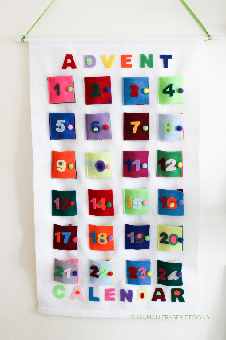 Handmade Advent calendar made from colorful felt against a white background | Shannon Fraser Designs
