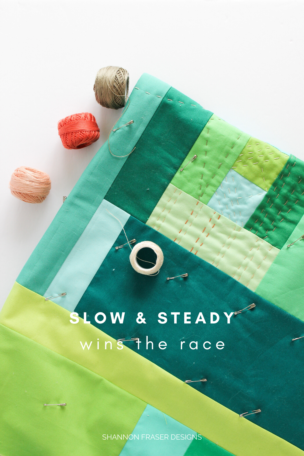 """F"" Quilt with spools of pearl cotton thread with ""slow and steady wins the race"" 