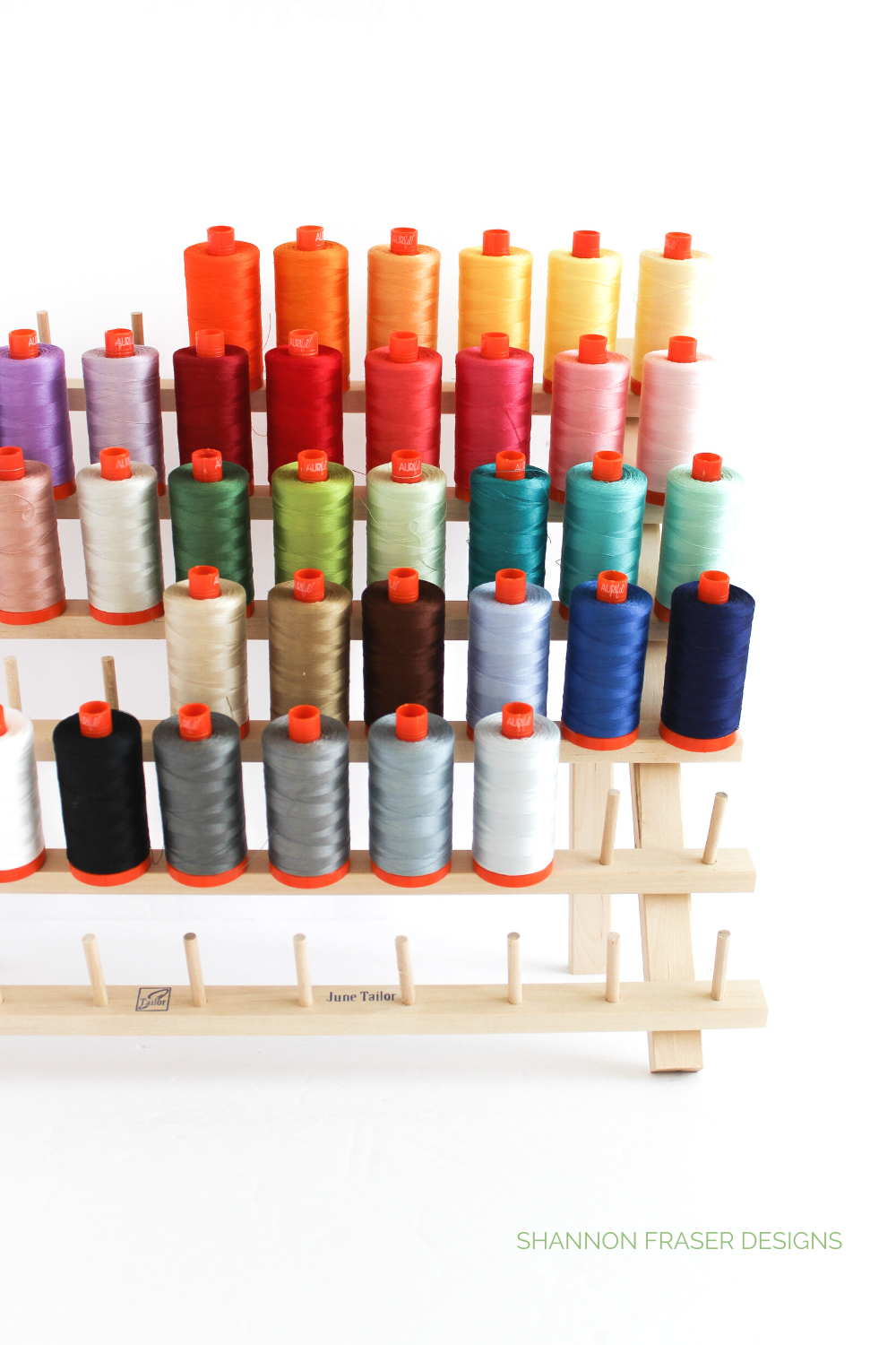 Wooden June Tailor thread rack with Aurifil Thread large spools in multi-colors | 2020 Aurifil Artisan Collection | Shannon Fraser Designs #threadrack