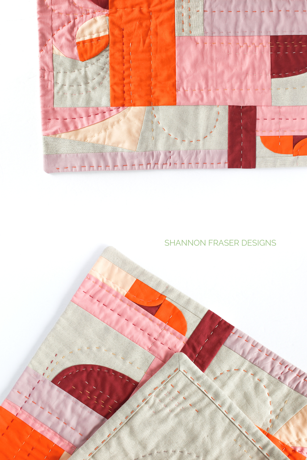 Hand quilting details on the Cloud Surfing improv wall hanging featuring faced binding | Shannon Fraser Designs #quilt