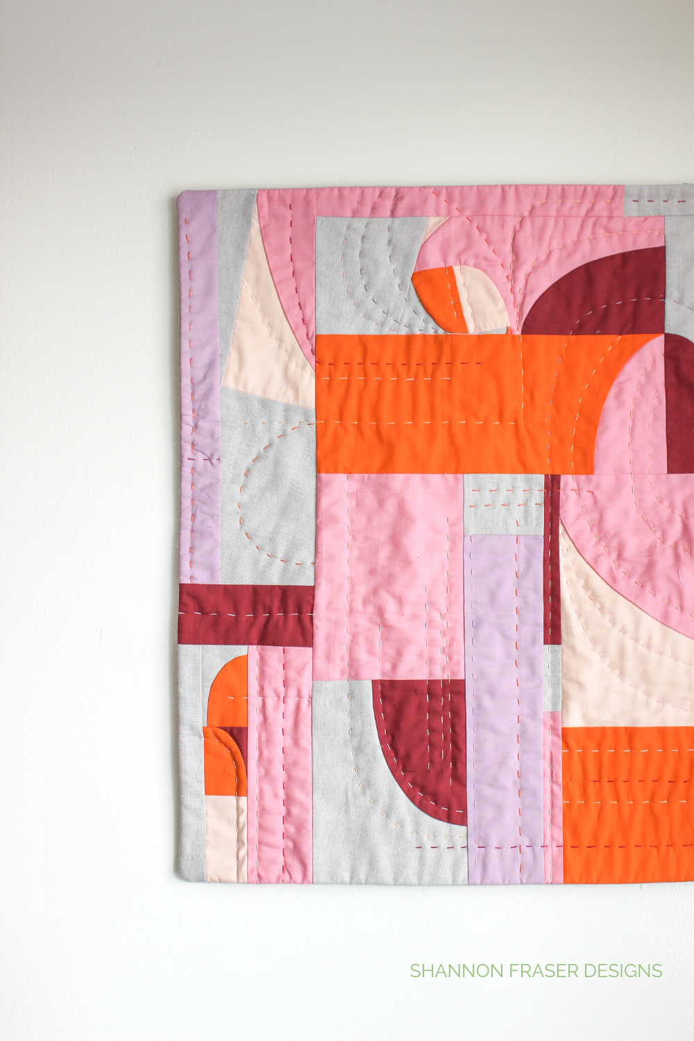 Modern improv quilted wall hanging featuring fabric scraps leftover from the Cloud Surfing quilt patterns | Shannon Fraser Designs #modernimprovquilting