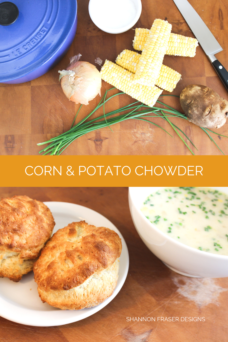 Corn and potato chowder ingredients on top and fully cooked and served in white bowls with fresh biscuits