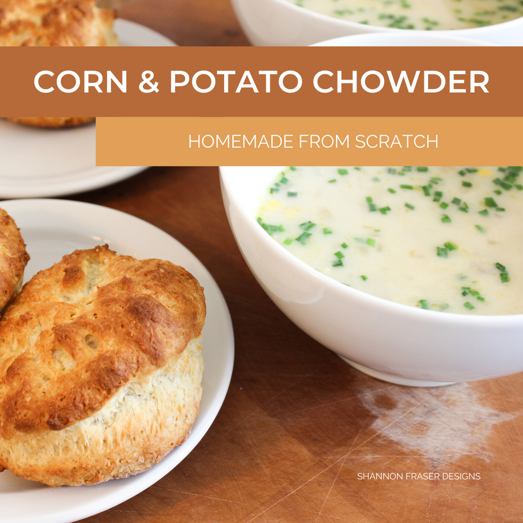 Bowl of corn & potato chowder with homemade biscuits