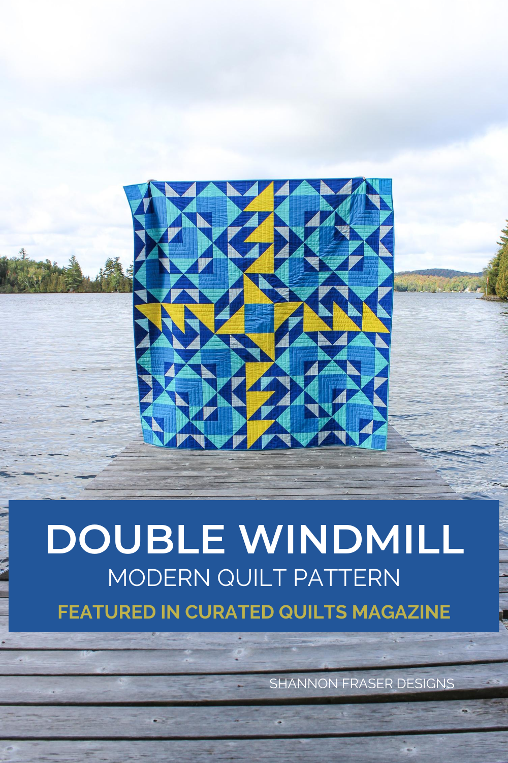 Blue and yellow Double Windmill Quilt on wooden dock in front of a lake | Shannon Fraser Designs #modernquiltpatterns