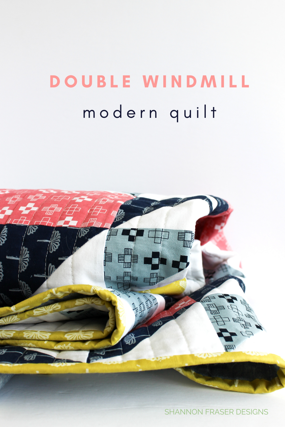 Double Windmill quilt featuring Blueberry Park Fabric by Karen Lewis Textiles folded on the table | Shannon Fraser Designs