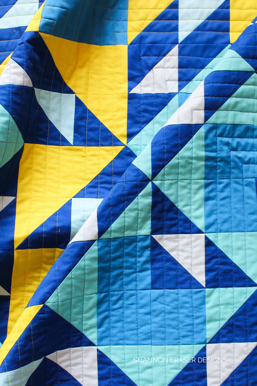 Blue ombre and yellow half square triangles featured in the Double Windmill Quilt | Shattered Star QAL Week 3: How to make HSTs | Shannon Fraser Designs #quilt