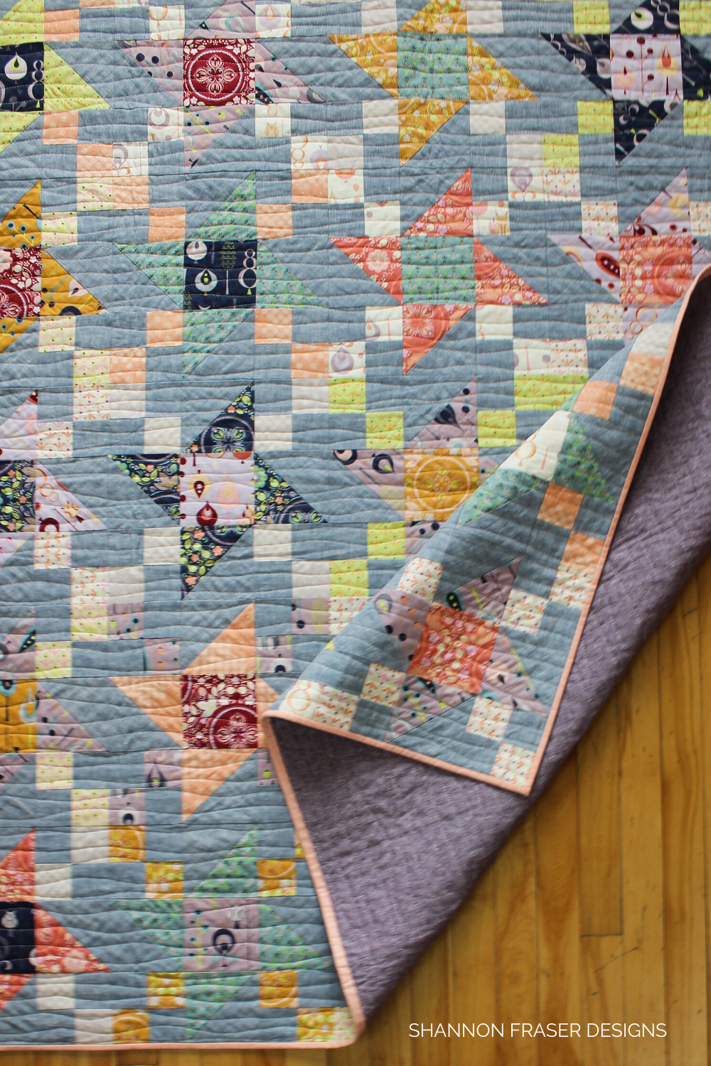 Quilting detail on the Autumn Irish Vortex quilt featuring a Leutenegger Fat Quarter Bundle + Brussels Washer Line Dyed Linen | Irish Vortex quilt pattern | Shannon Fraser Designs #quilts