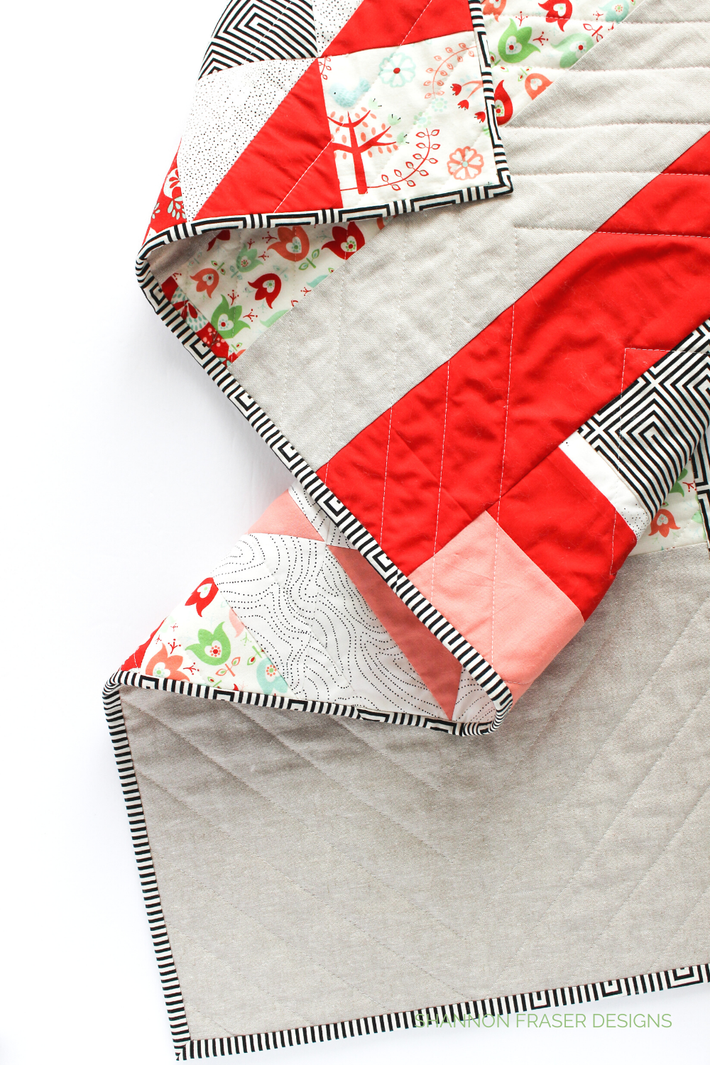 Improv quilted back on the Holiday Modern Aztec quilted table runner | 7 reasons why quilted table runners should be on your to gift list | Shannon Fraser Designs #tablerunner
