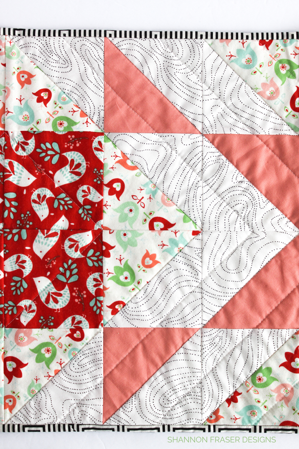 Quilting detail on the holiday scandinavian style Modern Aztec quilted table runner | Shannon Fraser Designs #quilting