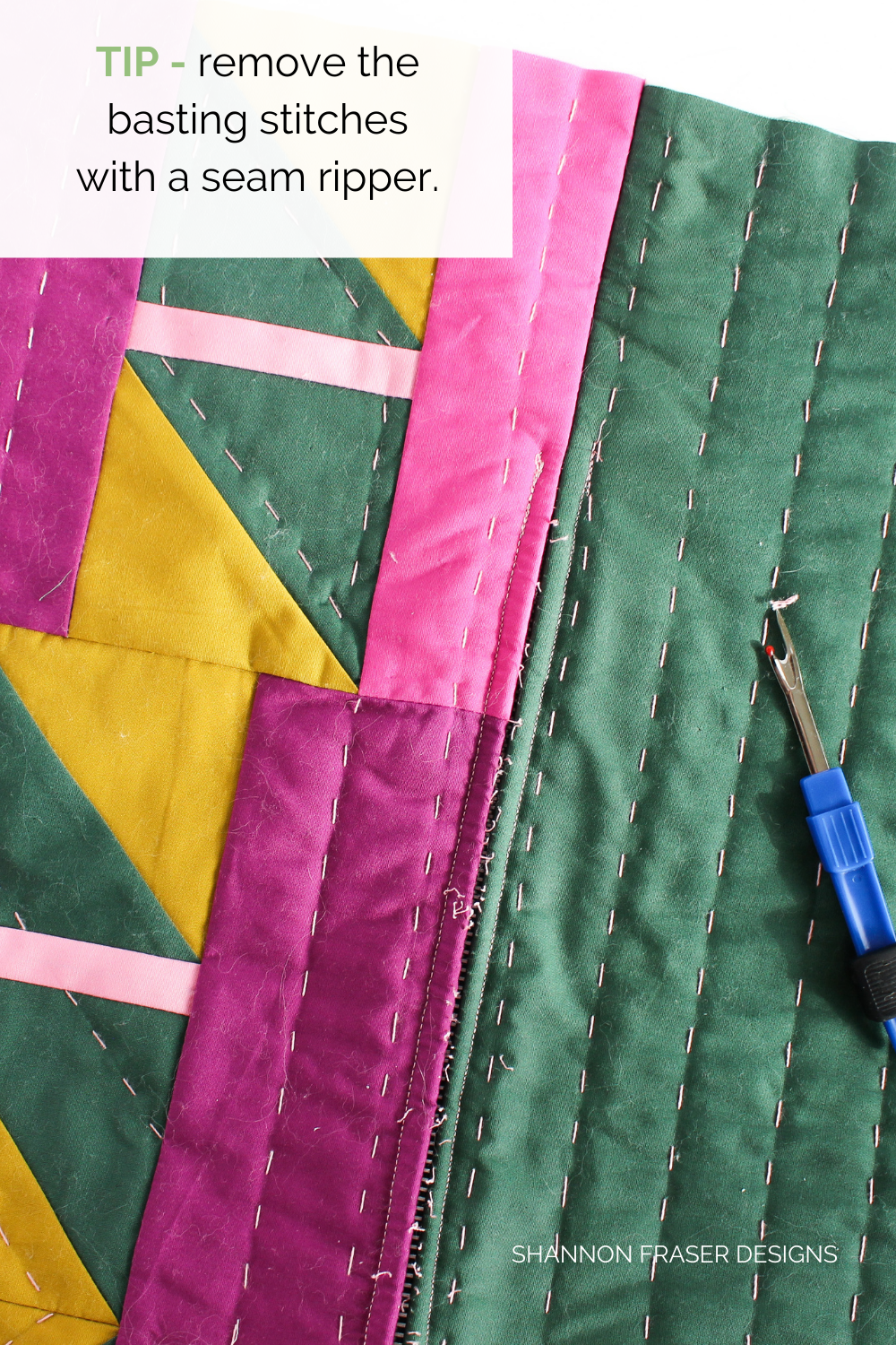 Use a seam ripper to gently remove your basted stitches from the bottom of your Shattered Star lumbar pillow | Sewing tutorial: how to install a metal zipper | Shannon Fraser Designs #quiltedpillow