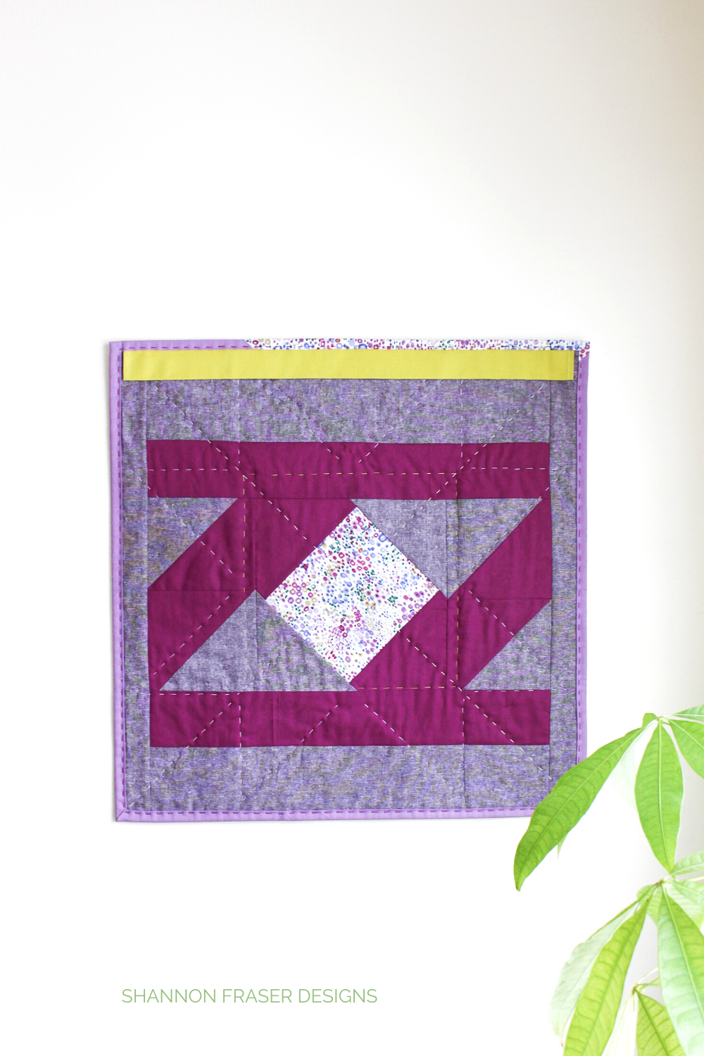 Purple, eggplant and wasabi colored improv quilt on the back of the Indian Star quilted mini wall hanging | Quilt Big Book Tour | Shannon Fraser Designs #modernimprovquilting