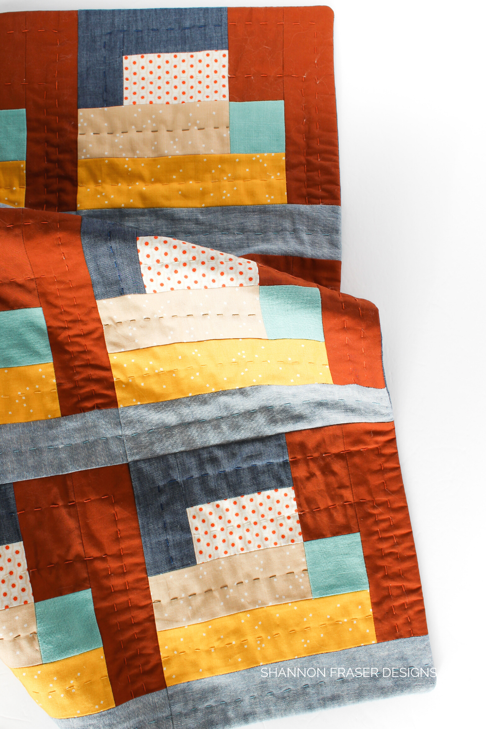Hand quilted details on the Landmark wall hanging from Urban Quilting Book | Shannon Fraser Designs #modernquilting