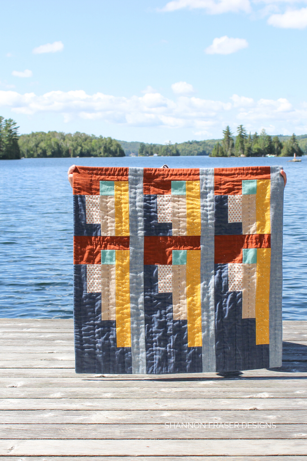 Landmark quilted wall hanging in the summer wild | Entirely hand quilted #modernlogcabinquilt
