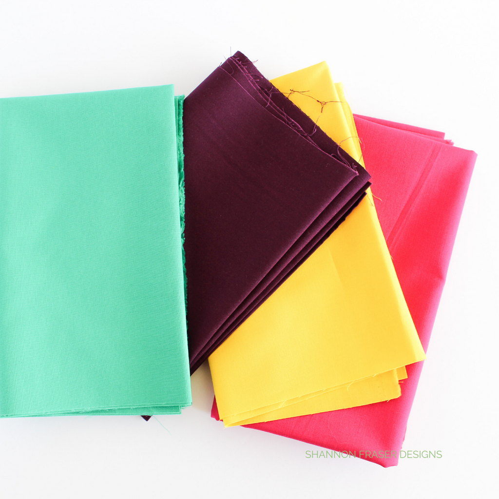 Kona Cotton in green, purple, yellow and pink