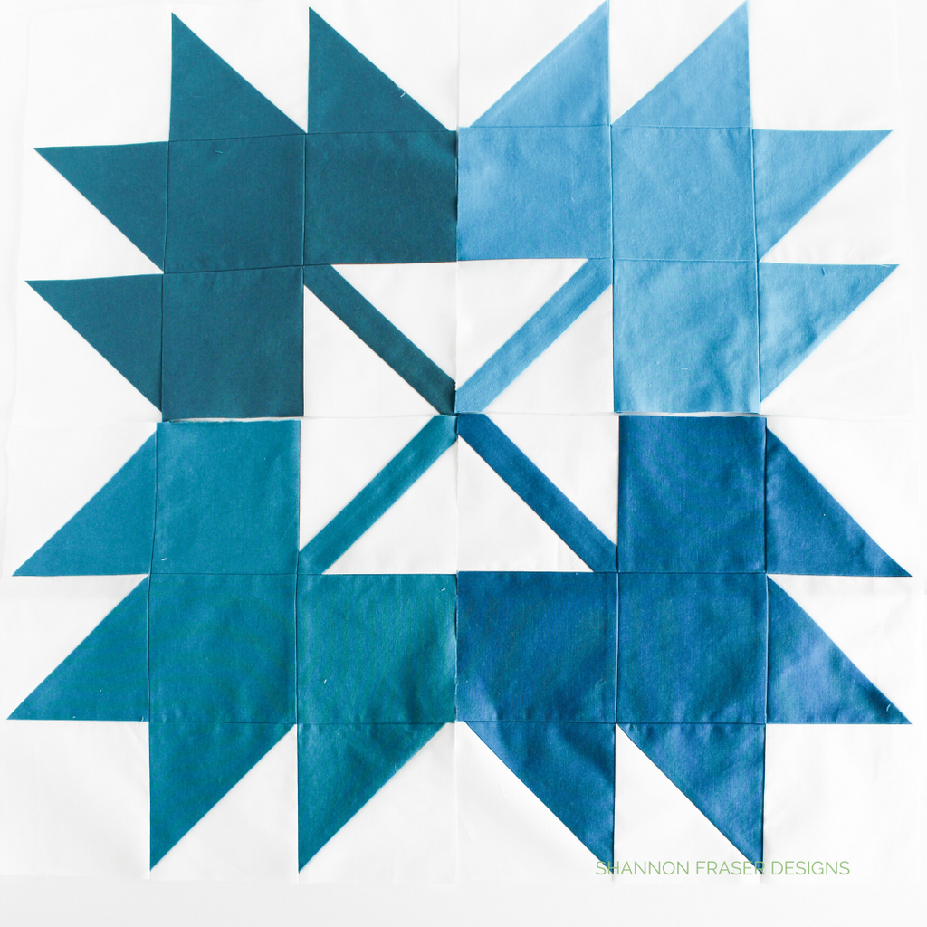 Maple leaf blocks in 4 different shades of blue forming a square and all pointing out