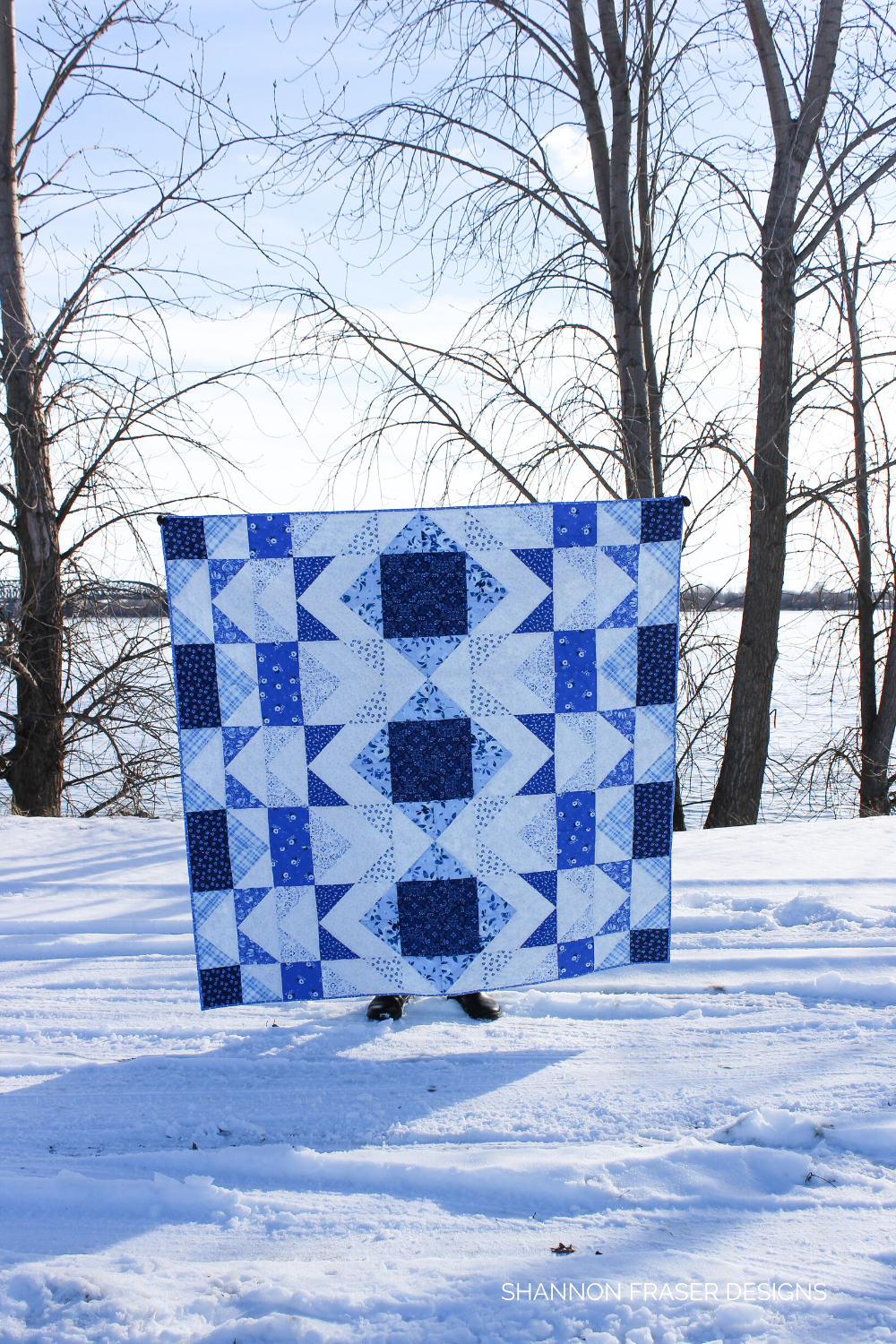 Blue and white modern quilt in the winter wild | Modern Aztec quilt featuring 10-color option in lap size, also comes in 5-color option and in mini, baby, lap, twin, double and queen sizes | Shannon Fraser Designs #modernquiltpattern