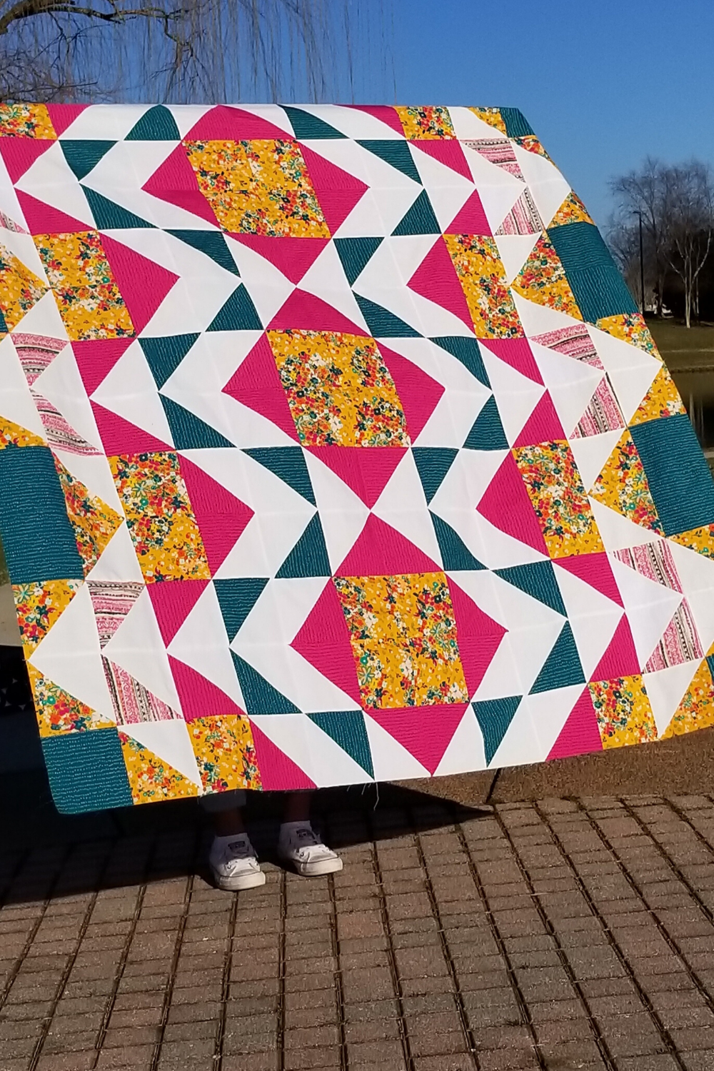 Fuchsia, teal, mustard and white Modern Aztec quilt in the wild - features half square triangles for a quick and easy piecing session | Modern Aztec quilt pattern | Shannon Fraser Designs #modernquilt