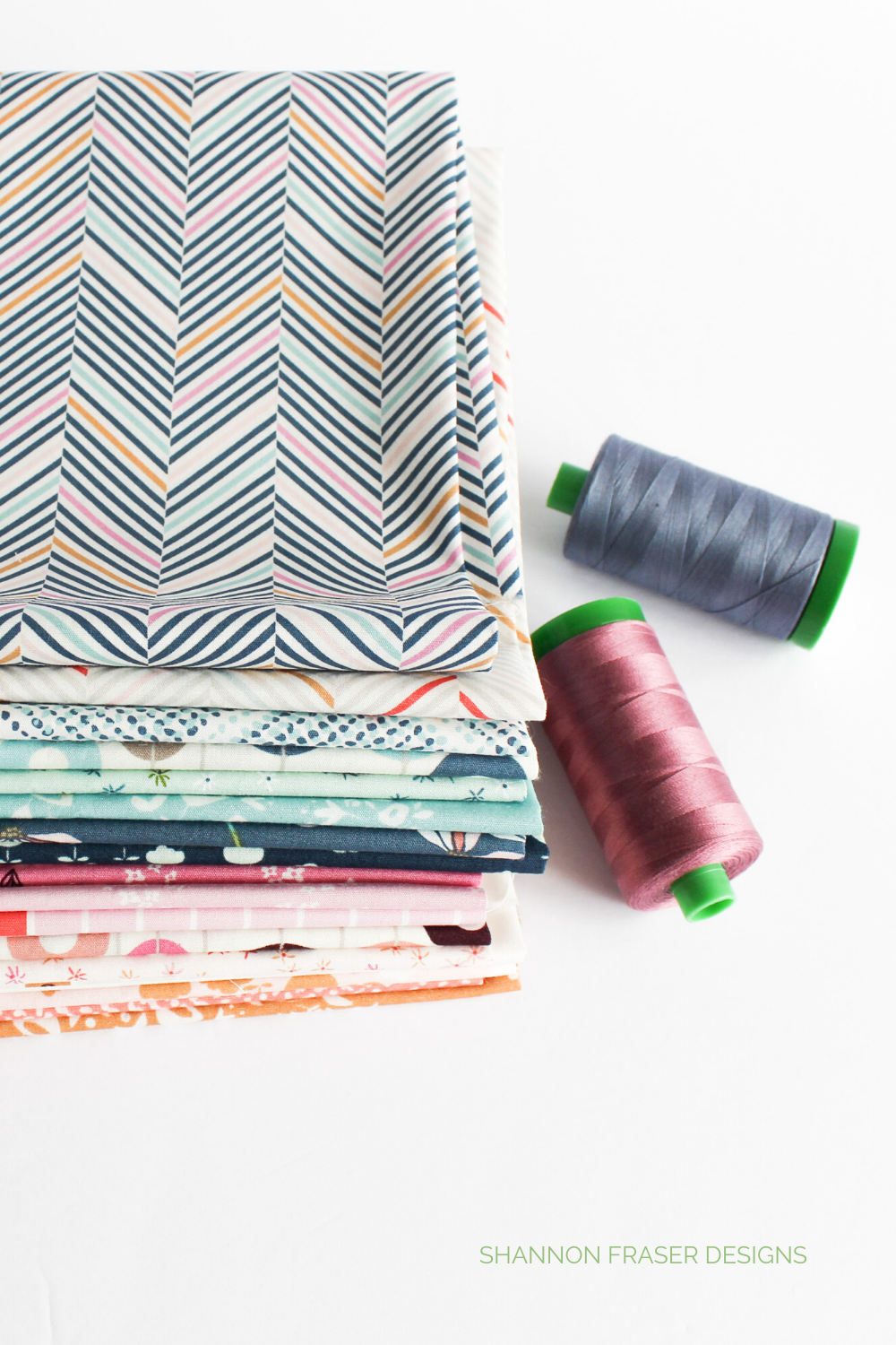 Stack of Playground Fat Quarters + 2 spools or Aurifil thread in 40wt | Playtime Quilt | Shannon Fraser Designs #fabric