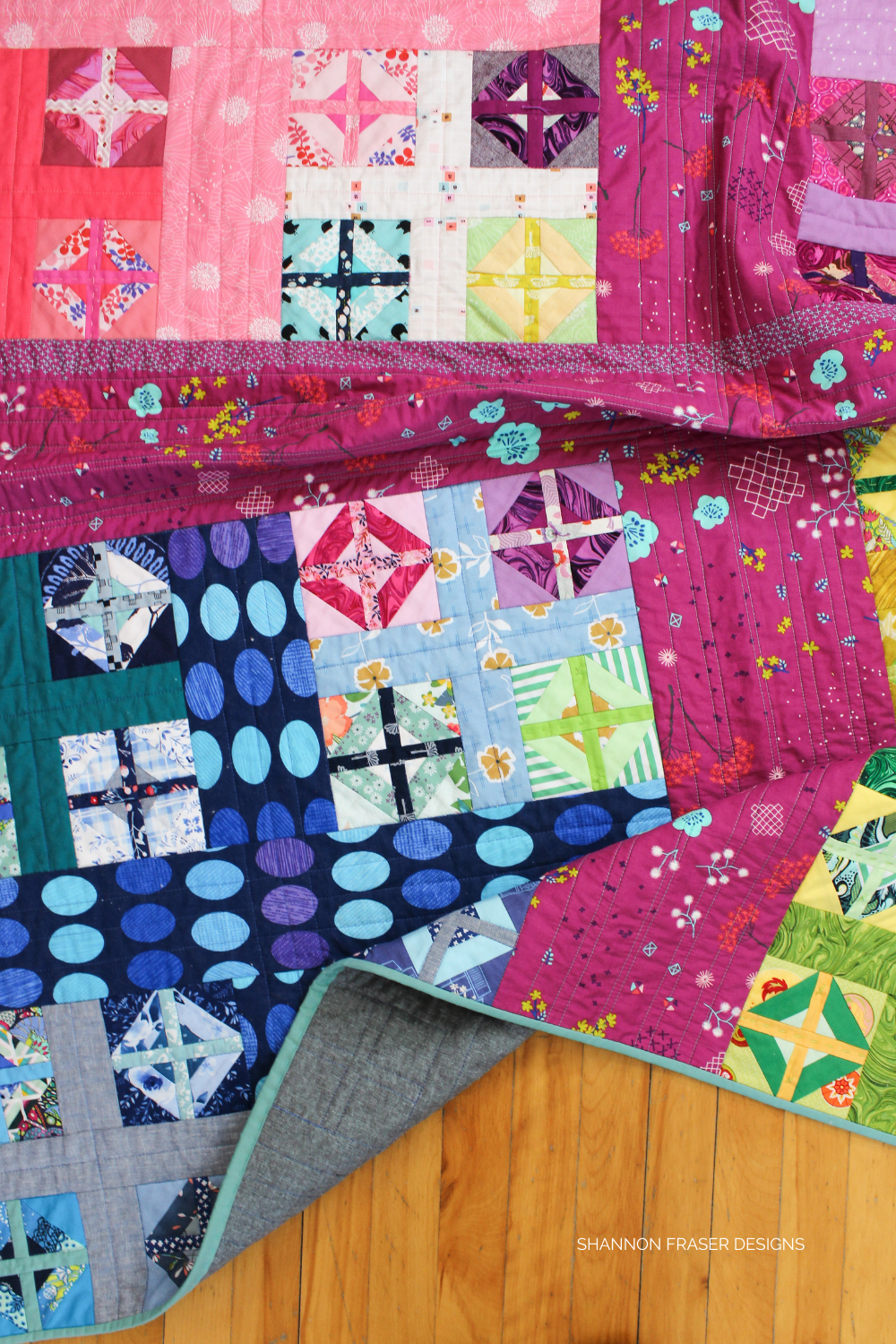 Rainbow scrappy version of the Plus Infinity quilt | beginner friendly quilt pattern that is also a great fabric scrap buster! #scrappyplusquilt
