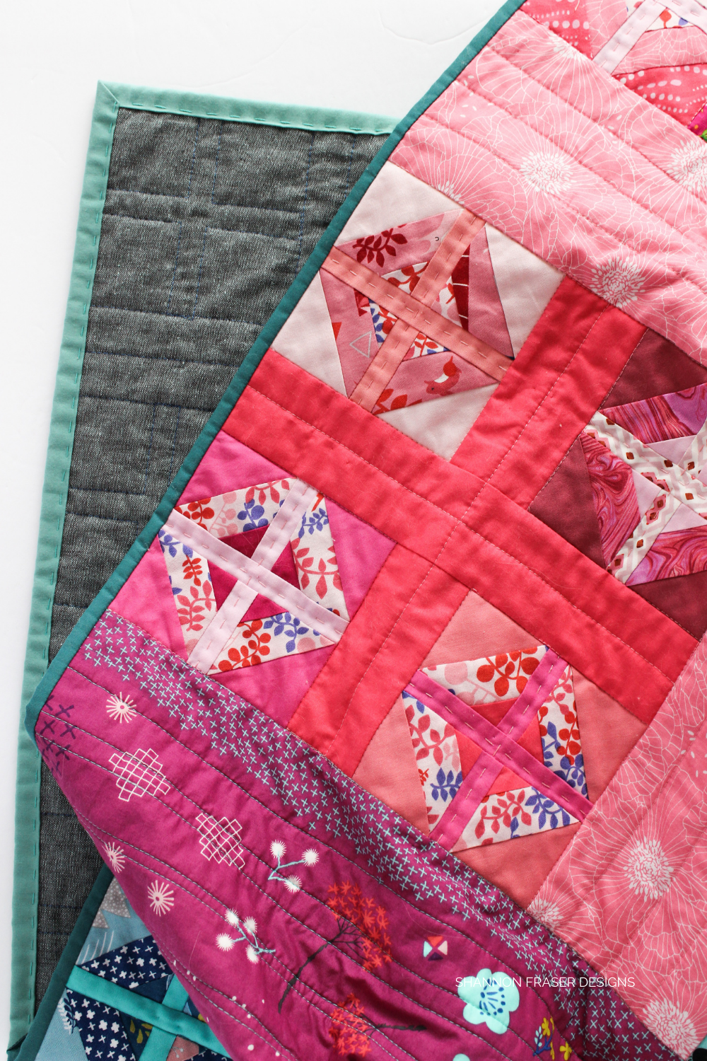 Pink plus blocks in the scrappy Plus Infinity quilt - busting through my fabric scraps to make a rainbow version | Modern quilt pattern | Shannon Fraser Designs #plusquilt