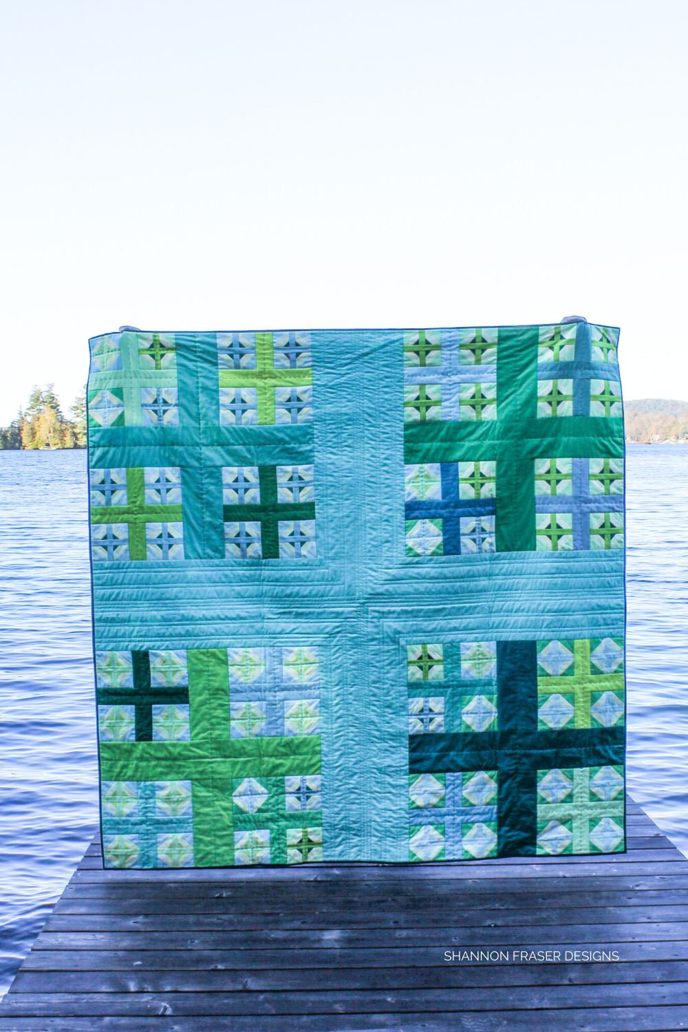 Plus Infinity Quilt in the wild on a dock in front of lake in the summer time | Shannon Fraser Designs