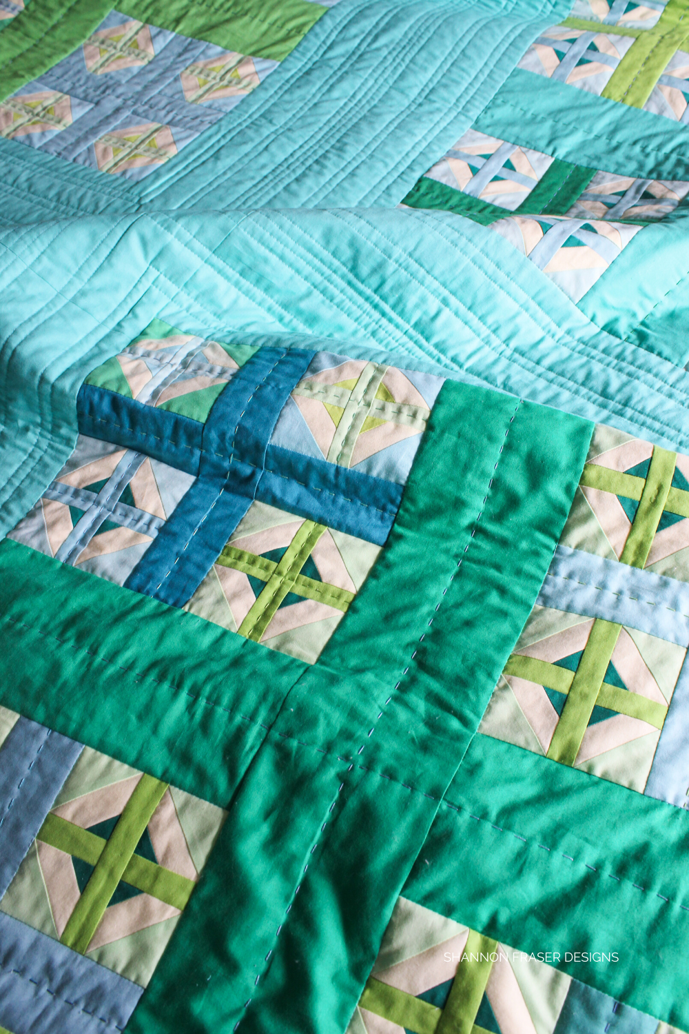 Close up of the hand quilting and machine quilted details on the Plus Infinity quilt laid out on the floor | Shannon Fraser Designs