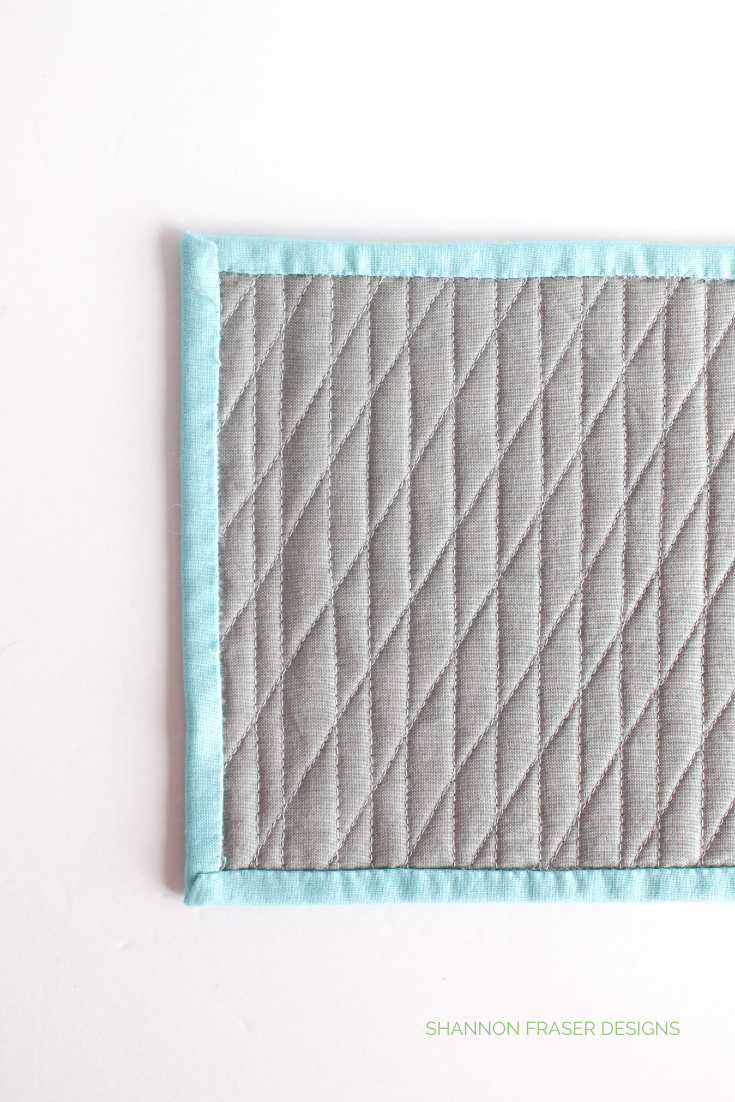 The back of the Iron princess quilted mug rug showing off the diagonal diamond quilting