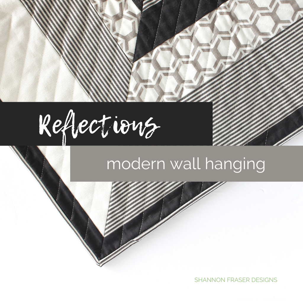 Reflections quilted wall hanging featuring upcycled fabrics | A Suzy Quilts Pattern #quiltedwallhanging
